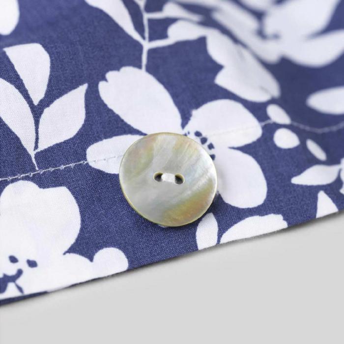 Copripiumino in percalle di cotone blu, fantasia fiori bianchi