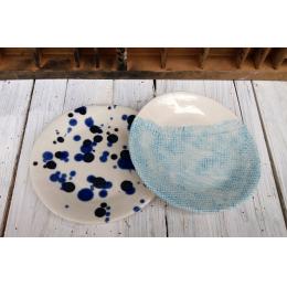 Set di due piattini di porcellana
