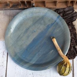 Piatto tondo in ceramica