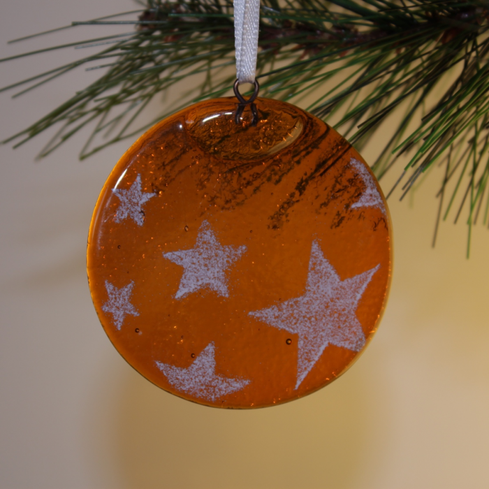 Tondo arancio con stelle